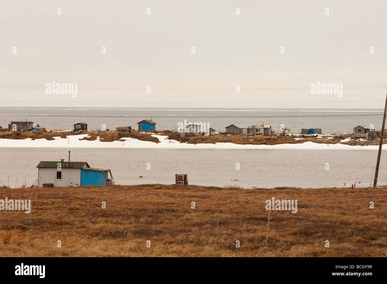 A SUBSISTENCE FISHING CAMP ONCE FORT DAVIS AT THE MOUTH OF THE NOME RIVER ON THE BERING SEA - Stock Image