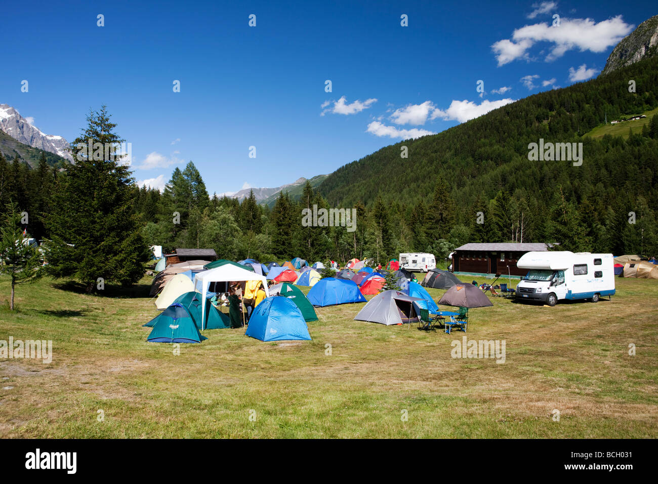 CAMPSITE IN THE ALPS. MONTE BIANCO, VAL VENY, COURMAYEUR, VALLE D'AOSTA, ITALY - Stock Image