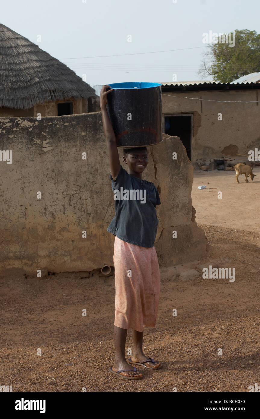 Girl fetching water village in Tamale Ghana - Stock Image