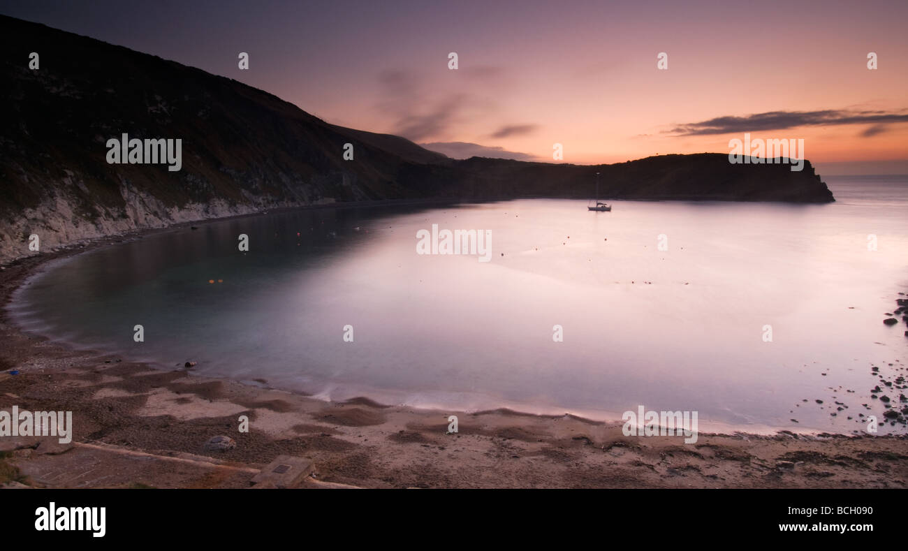 Dawn breaking over Lulworth Cove on the Isle of Purbeck South Dorset South West England UK Stock Photo
