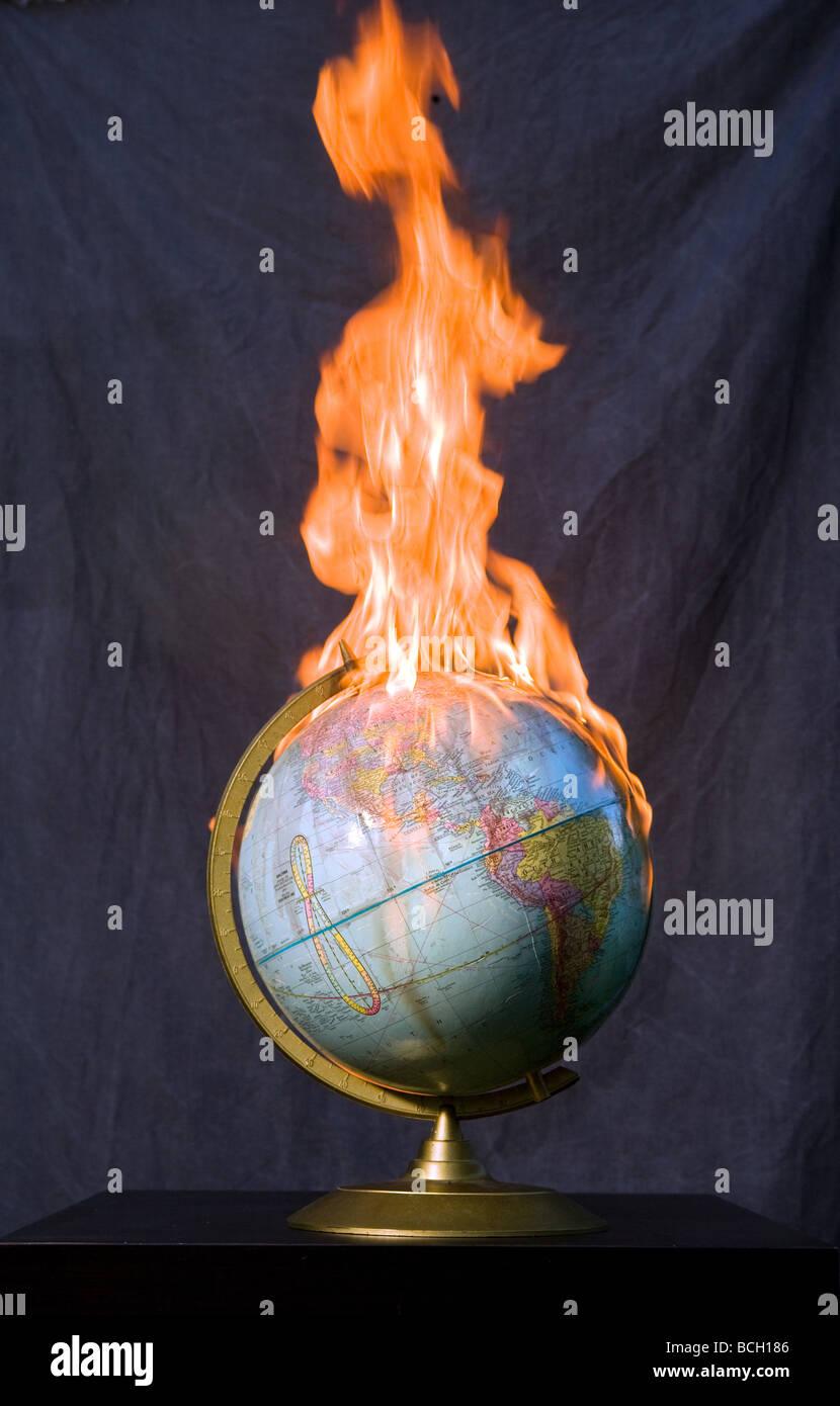A Globe on fire. Global Warming. War - Stock Image