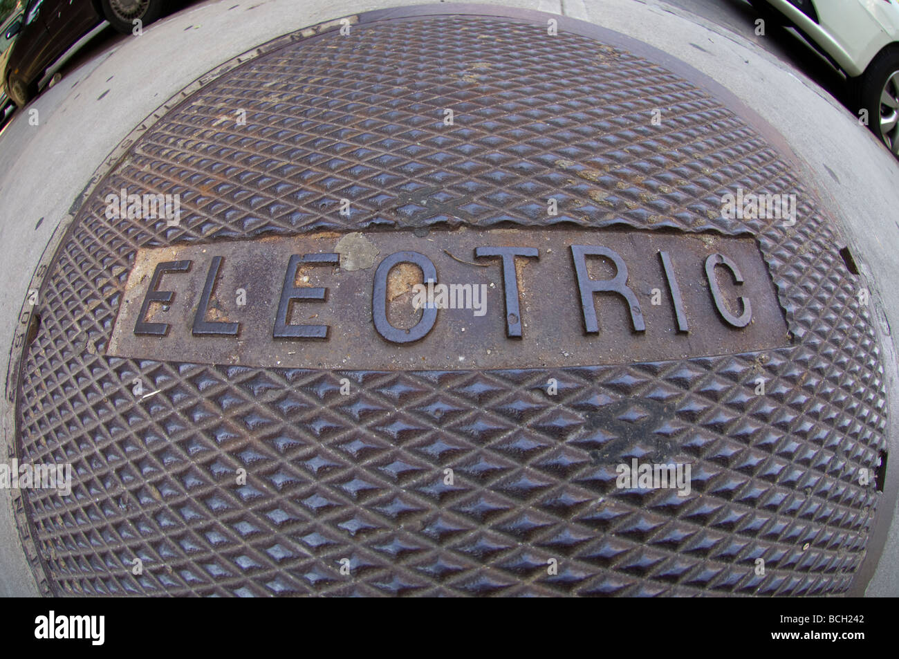 A manhole cover protecting electrical cables in the Chelsea neighborhood in New York - Stock Image