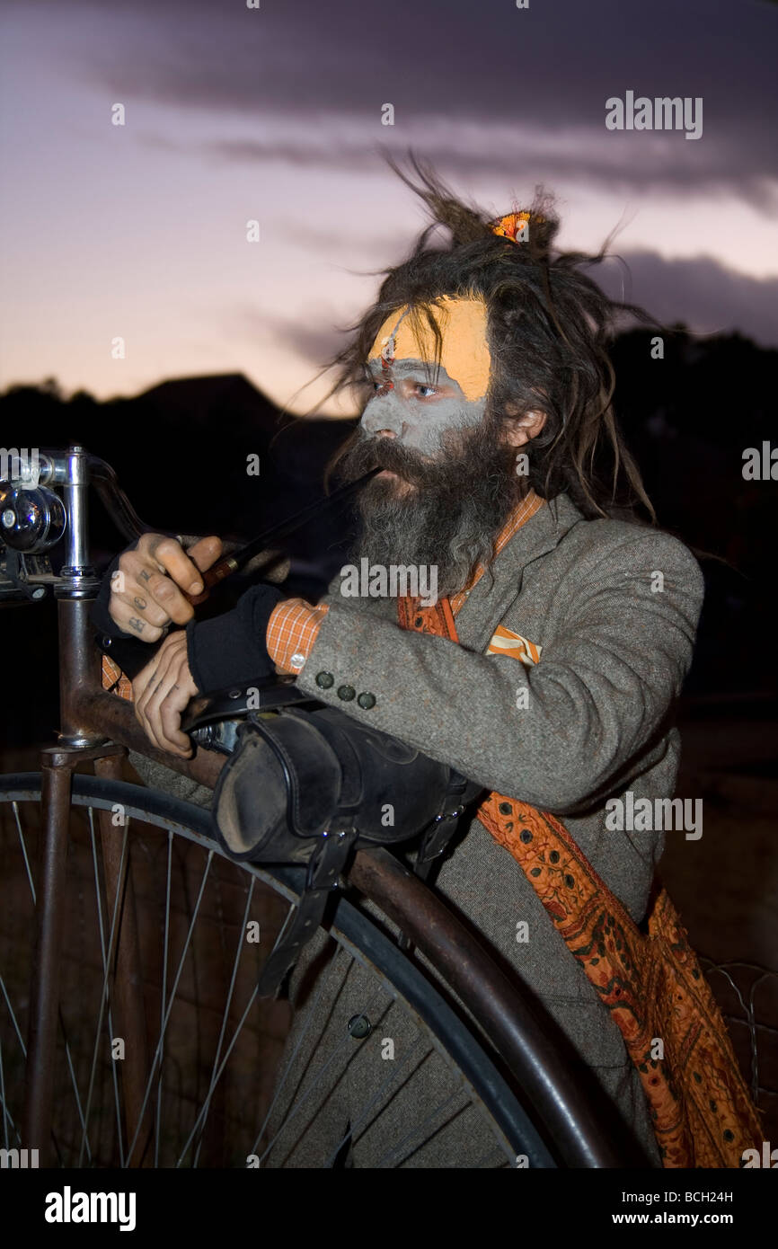 Tim Denham of Tucson holds onto his ordinary bicycle prior to the start of the 2008 All Souls Procession - Stock Image