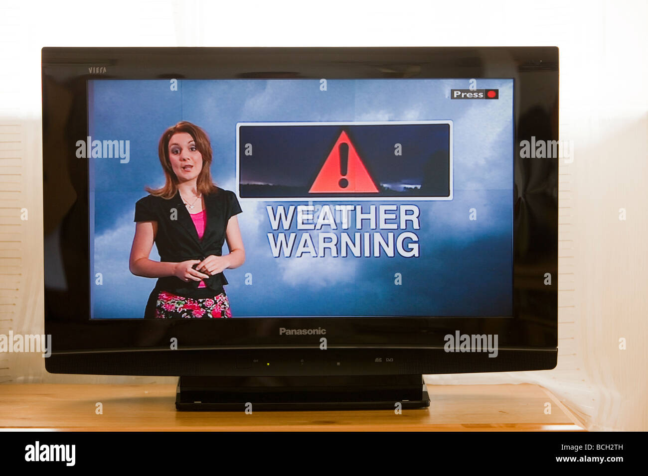 A TV weather forecast forecasting a thunderstorm in the UK - Stock Image