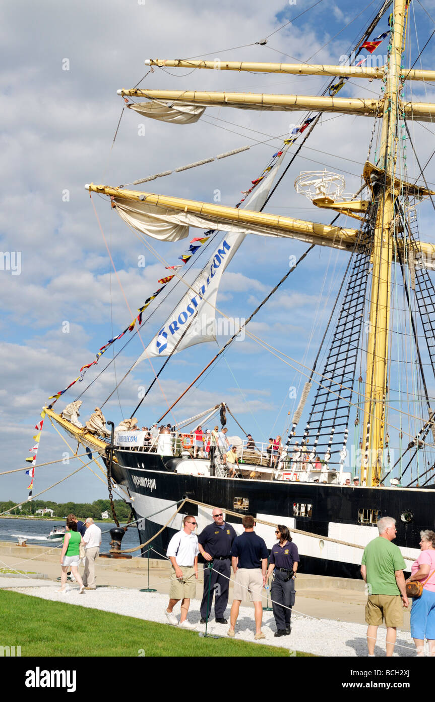 People touring the Tall Ship Kruzenshtern at dock with security guards in front - Stock Image