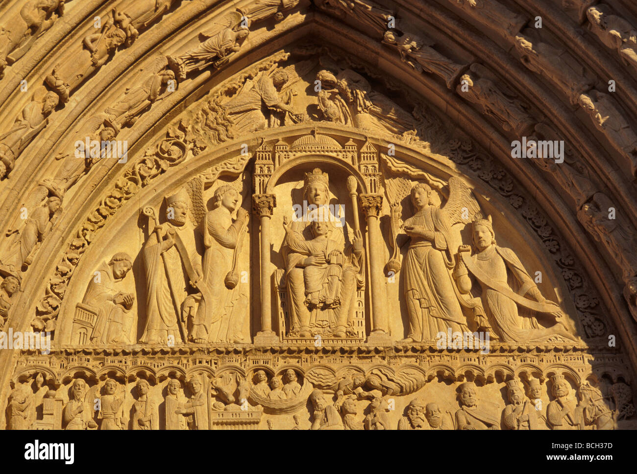 Portal of Sainte Anne at Notre Dame at sunset in Paris France Stock Photo