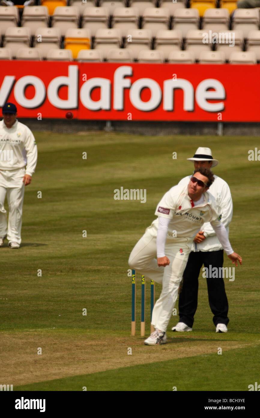 Off-Spin Bowler Robert Croft bowling for Glamorgan in the County Championship - Stock Image