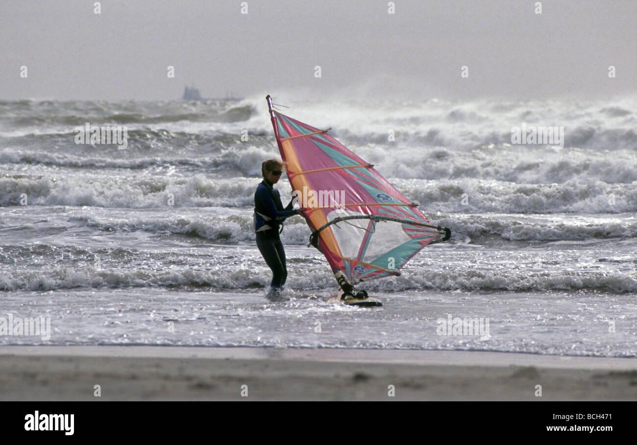 A windsurfer braves high surf and wind near Aransas Pass Texas on the Gulf Coast - Stock Image