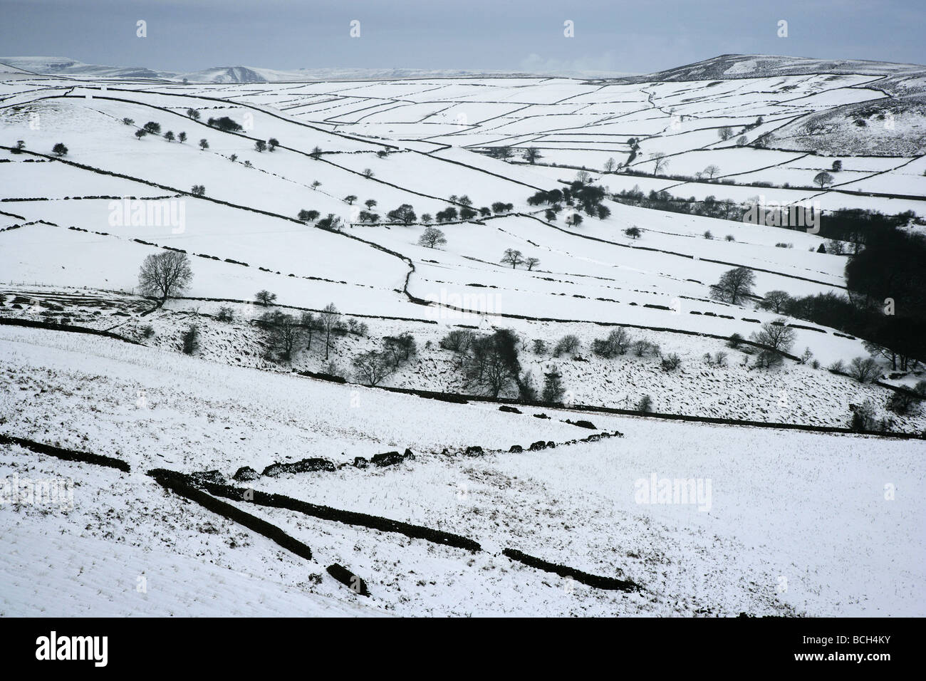 Landscape near Hathersage in the Derbyshire Peak District with Mam Tor and Lose Hill on the horizon in winter - Stock Image