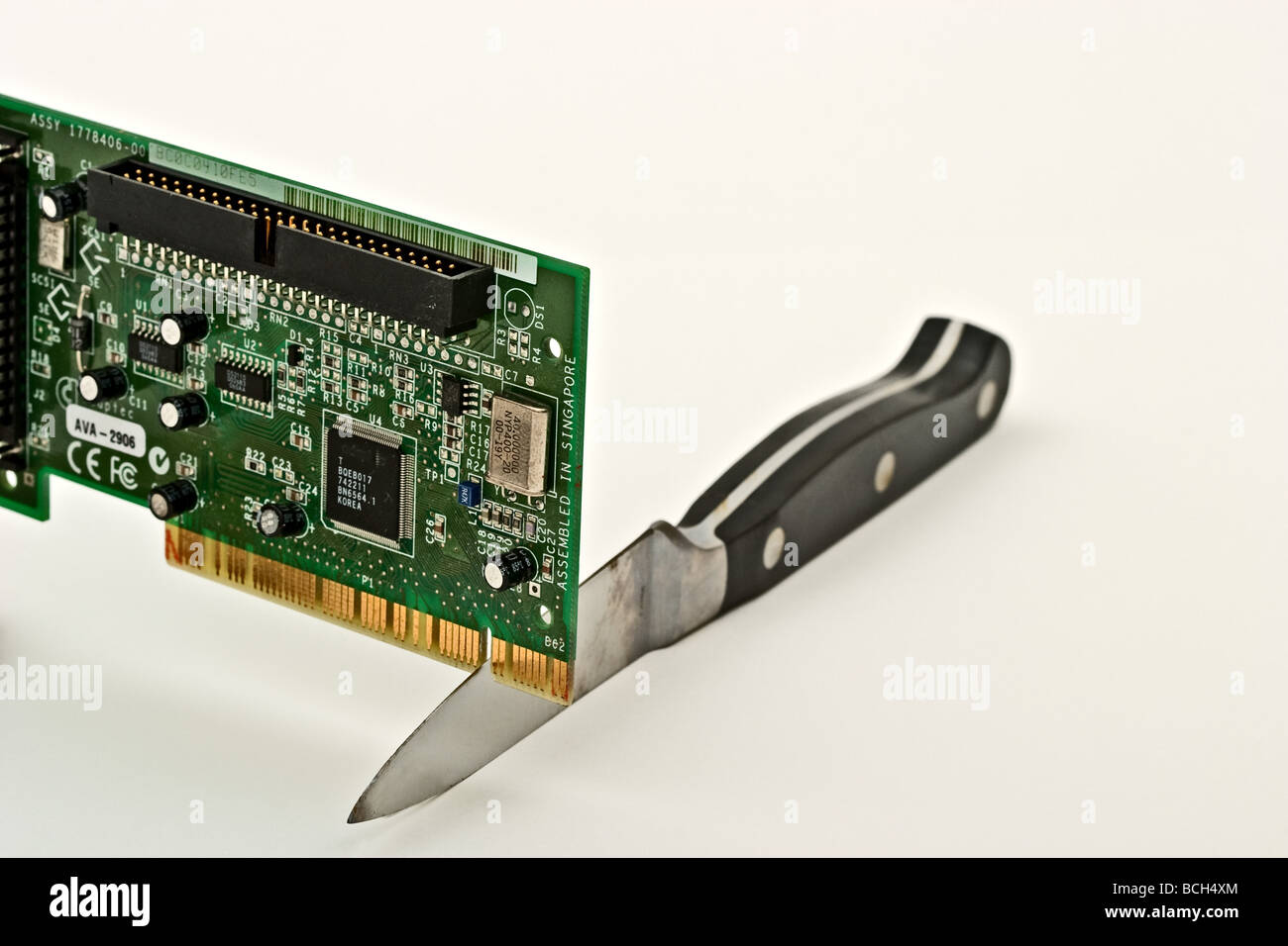 Circuit Board Cut Out Stock Photos Cutting Sharp Knife Into A Image