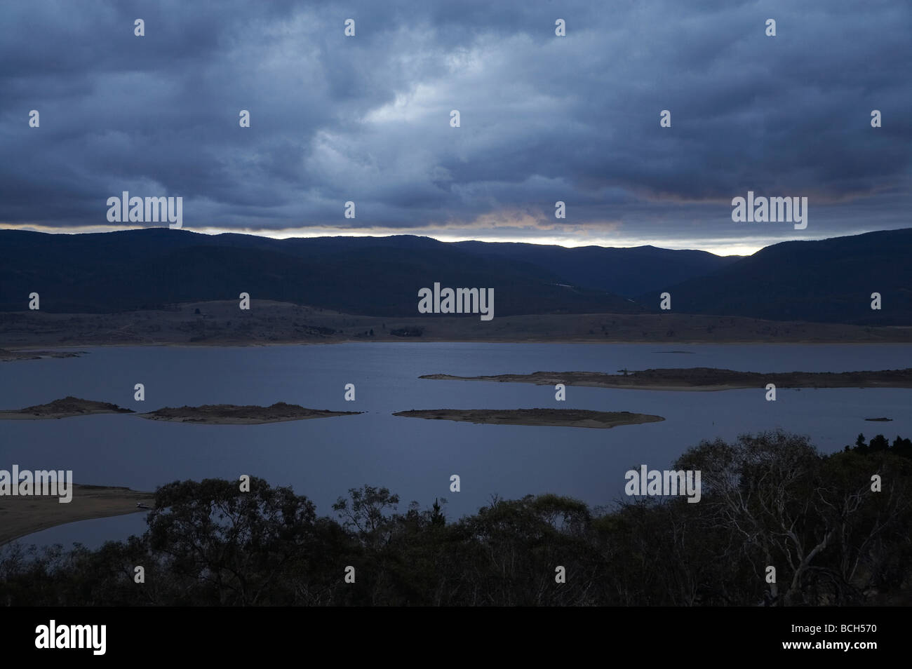 Dark Clouds over Lake Jindabyne Snowy Mountains New South Wales Australia - Stock Image