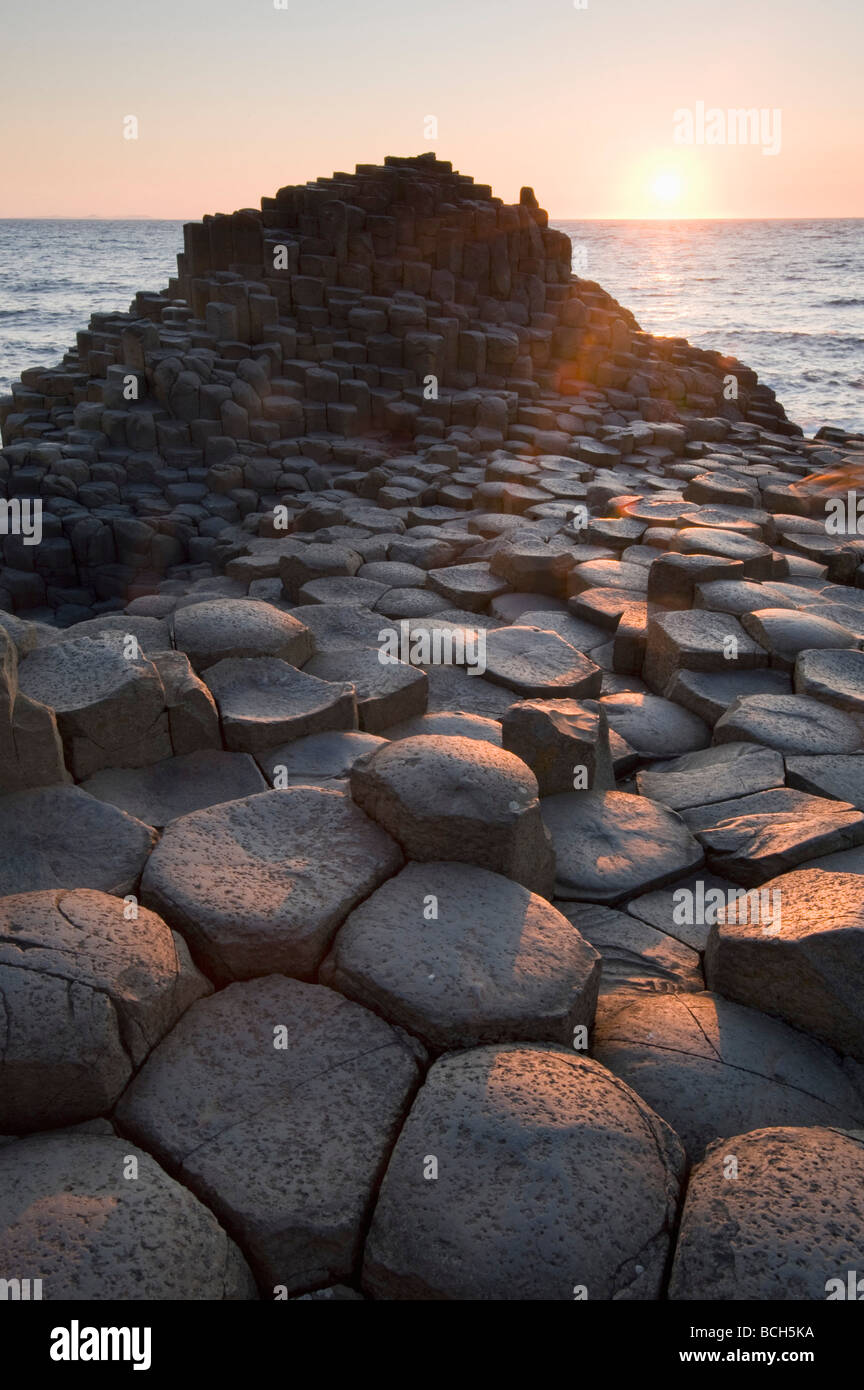 Sunset and Columnar Basalt, Giant's Causeway , World Heritage Site, County Antrim, Northern Ireland - Stock Image