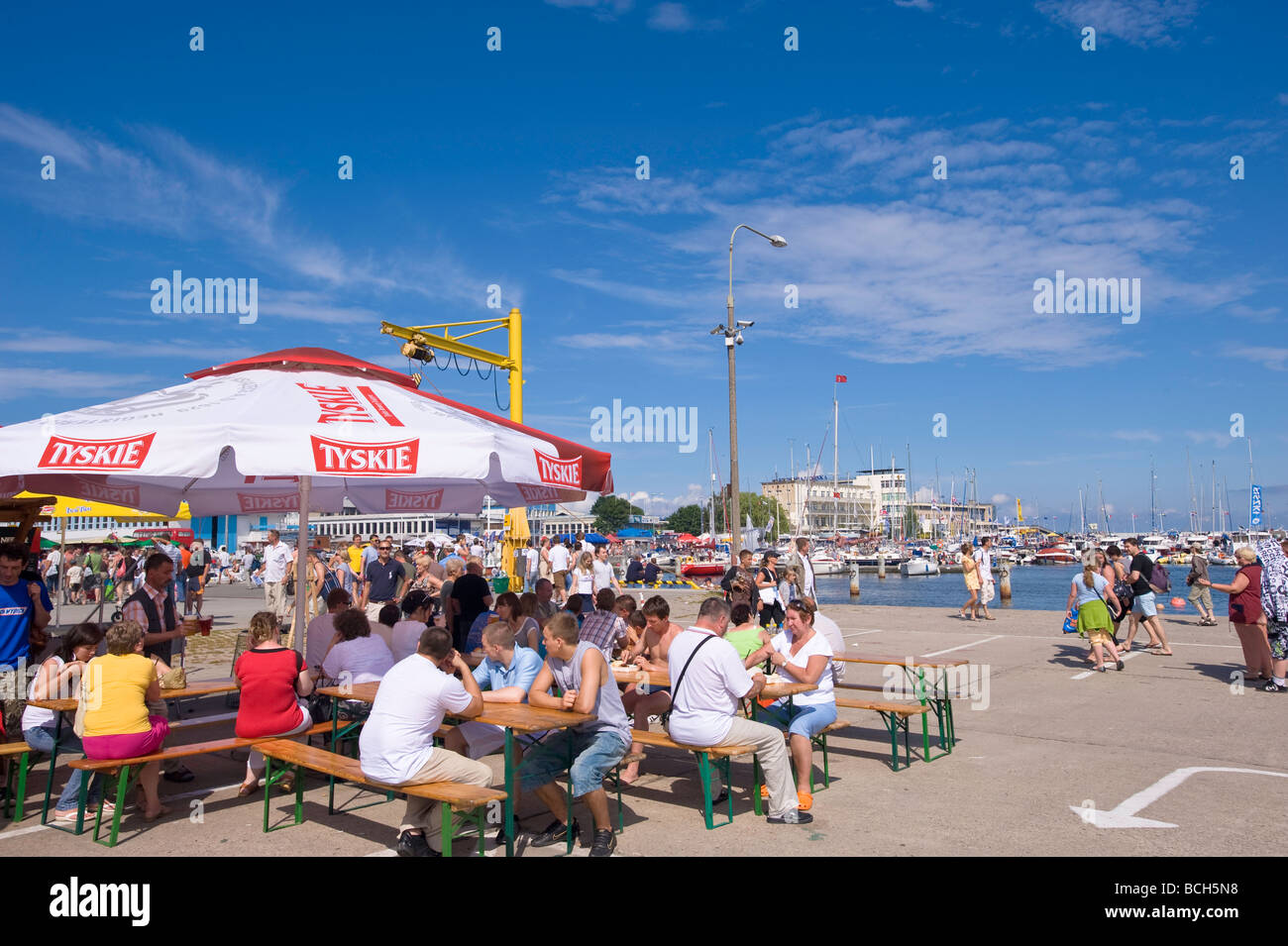 People relax in a bar on Kosciuszko Square by the marina Gdynia Poland Stock Photo