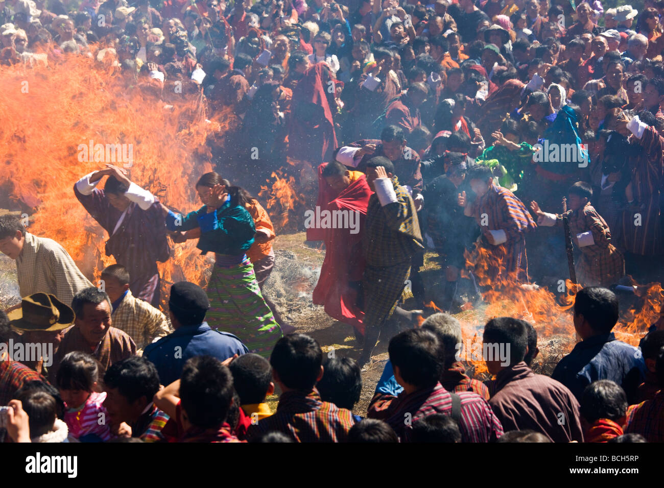 Running through fire to be purified Thangbi Festival Jaker Bumthang Valley Bhutan - Stock Image