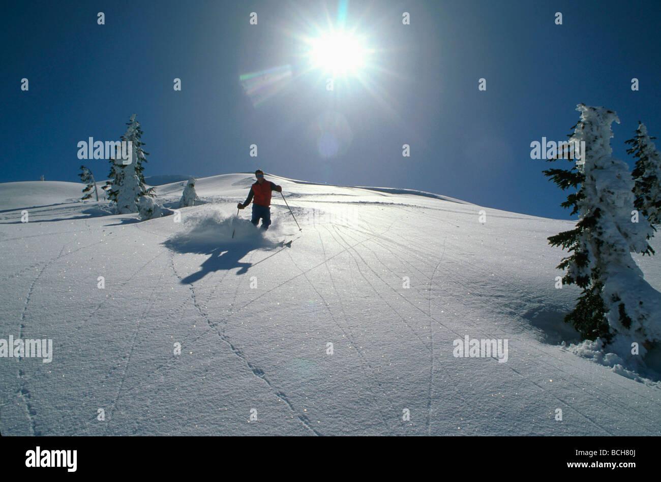 man downhill skiing southeast ak at ski resort juneau coast mtns