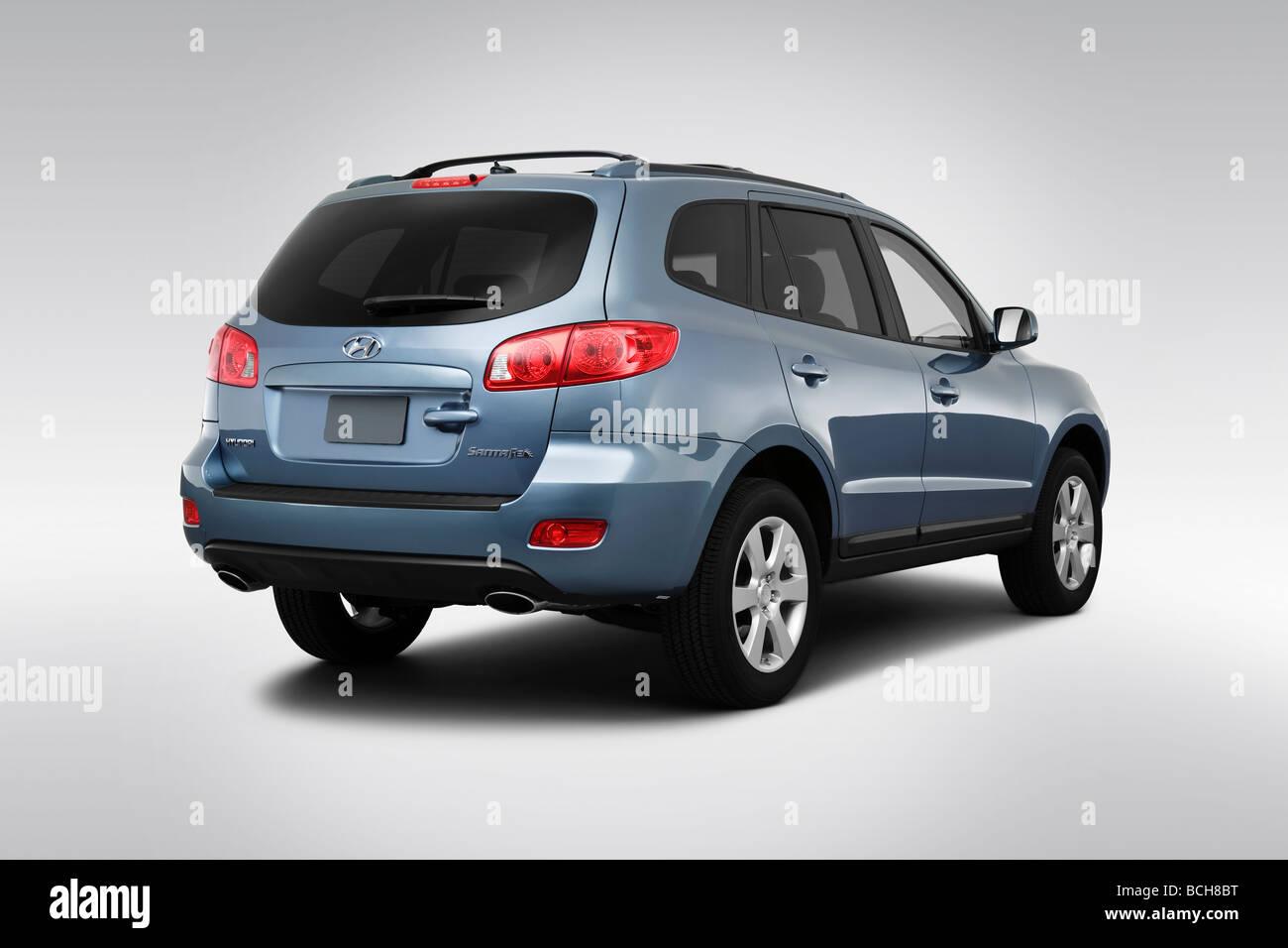 2009 Hyundai Santa Fe SE in Blue - Rear angle view - Stock Image