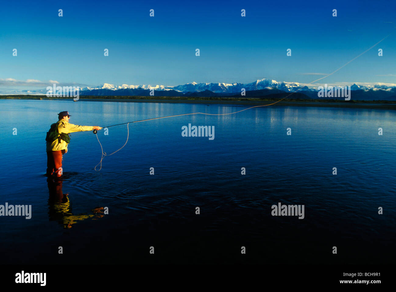 Man fly fishing on the Tsui River, Southeast Alaska, Summer - Stock Image
