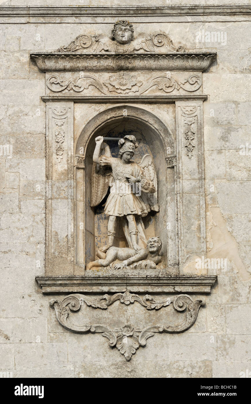 Monte Sant' Angelo Puglia Italy Sculpture of San Michele Arcangelo set in the wall of the sanctuary - Stock Image