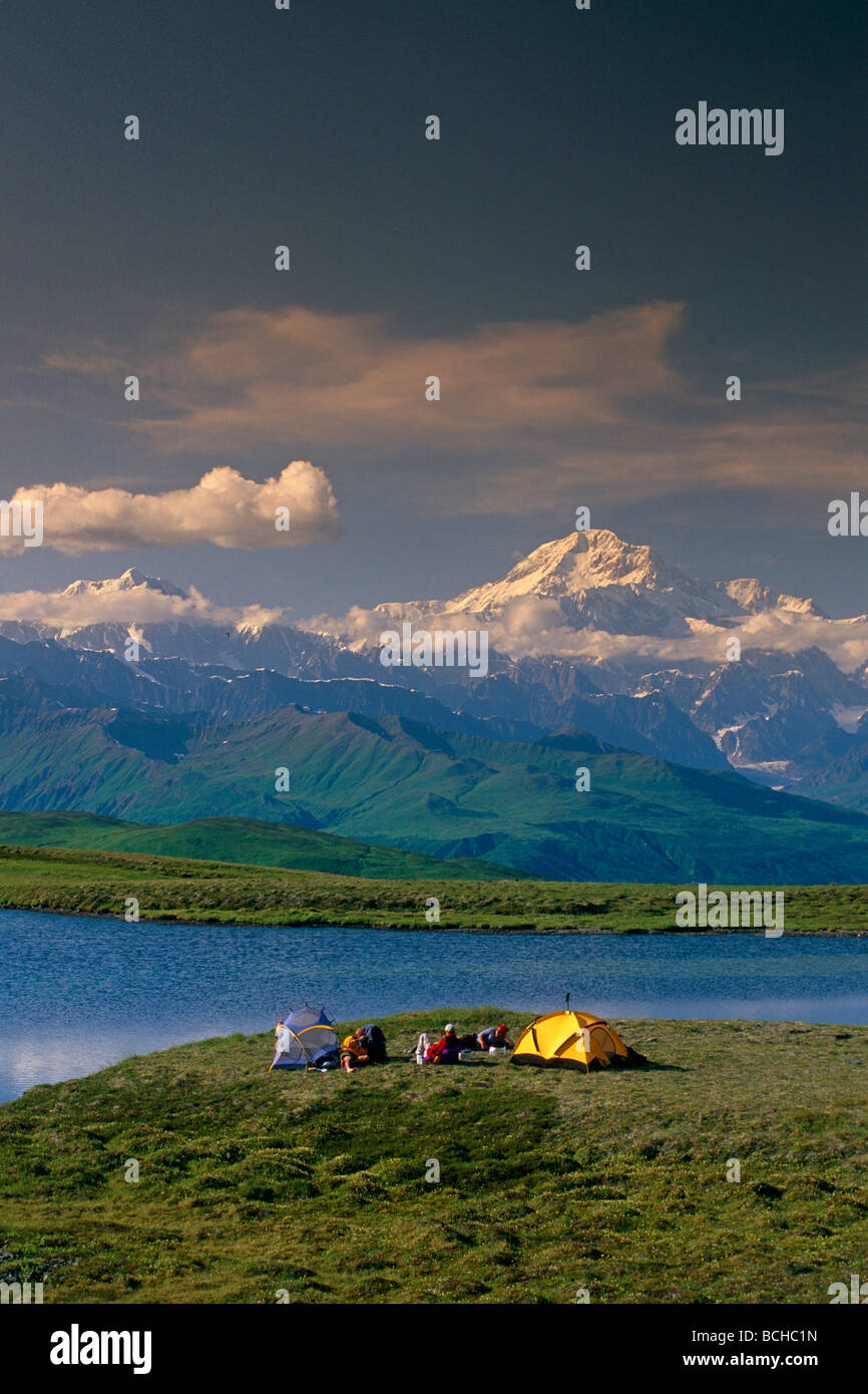 Hikers @ Camp near Tundra Pond Denali SP SC AK Summer/nw/Mt McKinley background - Stock Image