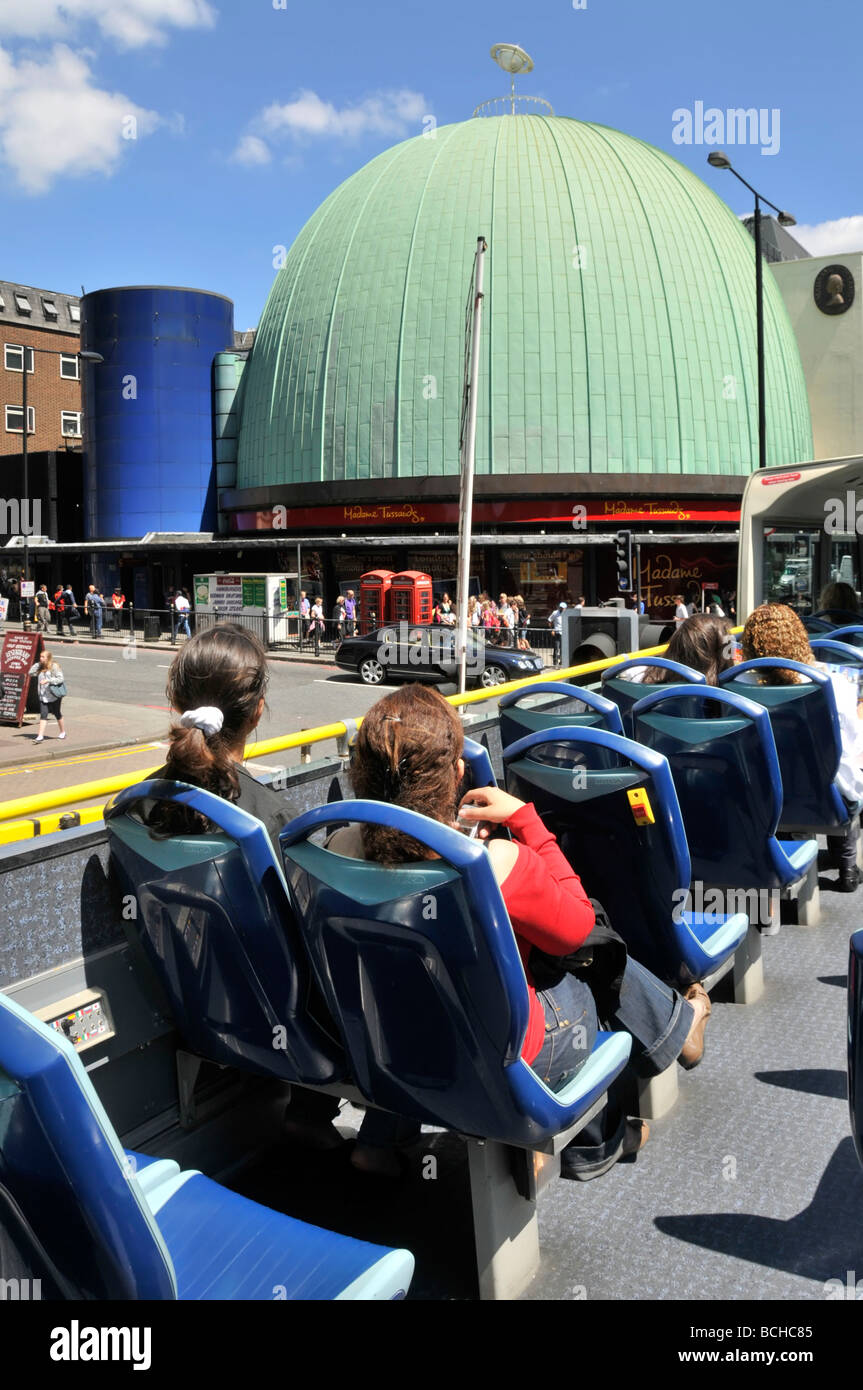 The dome of the Madame Tussauds London museum building seen by tourists on open top bus tour - Stock Image