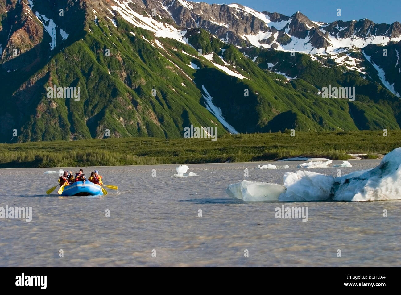 Rafting group paddles across Miles Lake to finish a 250-mile expedtion in the Copper River drainage Southcentral - Stock Image
