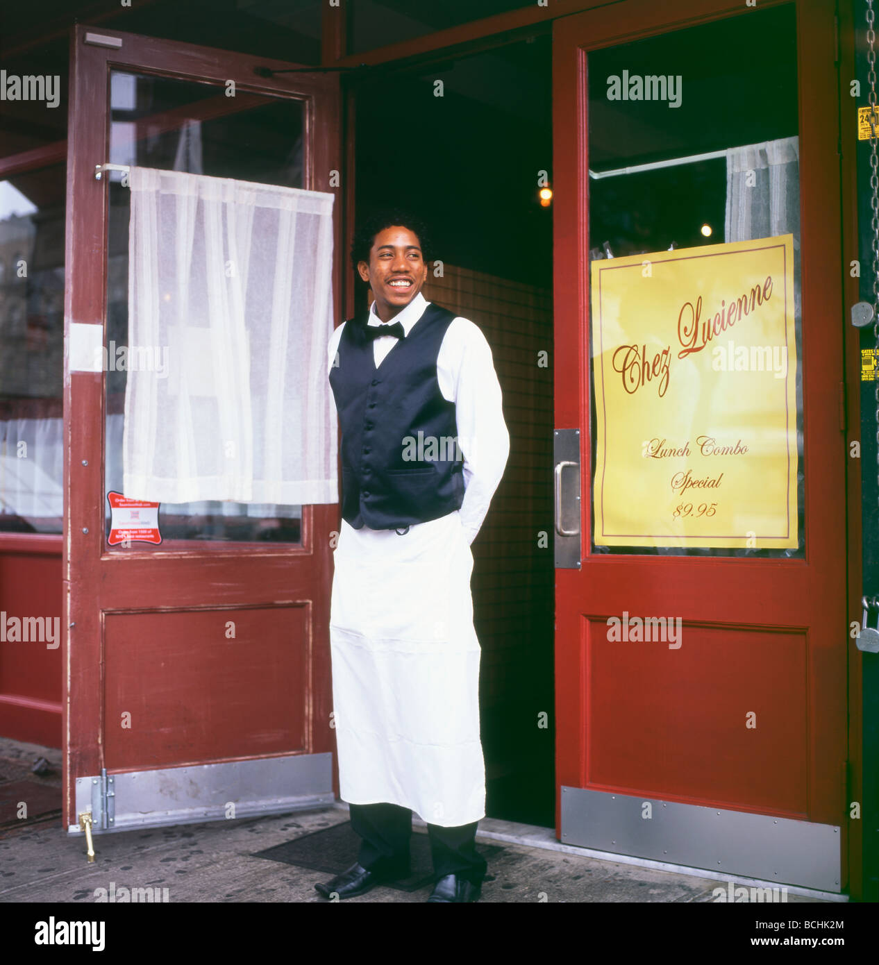 A young waiter at Chez Lucienne restaurant Harlem Manhattan NYC - Stock Image