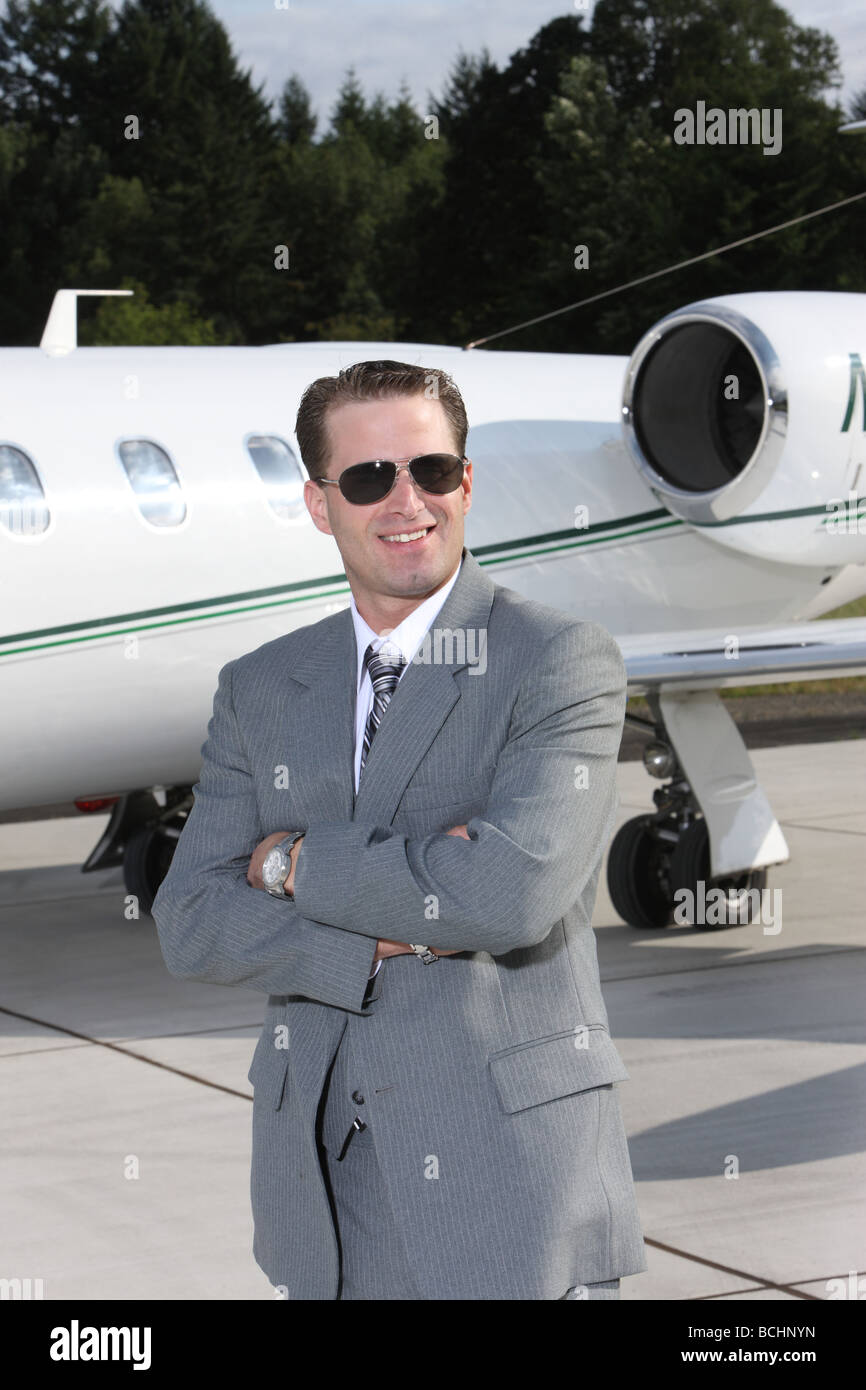 Businessman with corporate jet - Stock Image