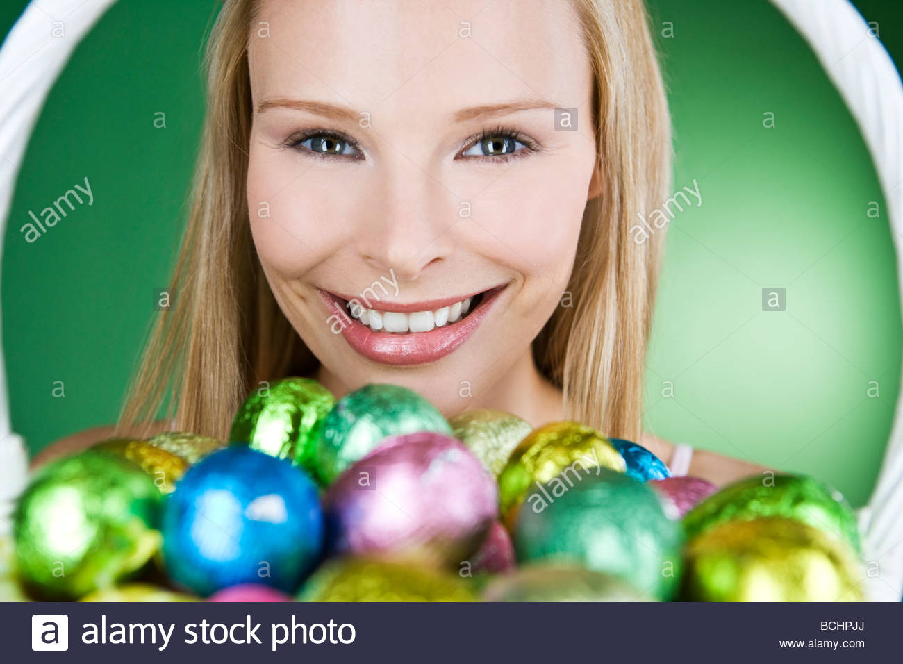 A Young Woman Holding Basket Of Easter Eggs