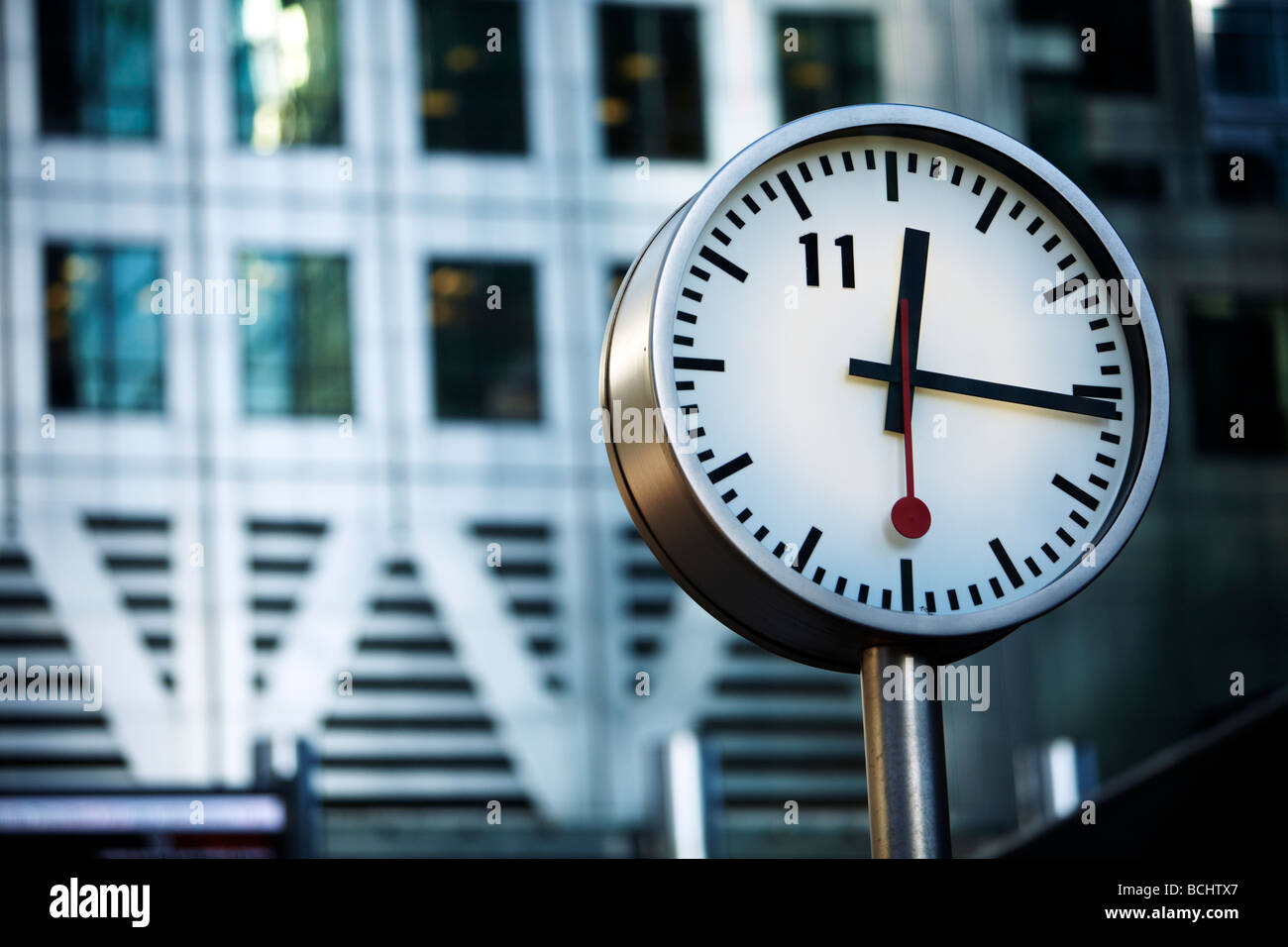 Konstantin Grcic designed Clock in front of One Canada Square Canary Wharf Docklands London UK - Stock Image