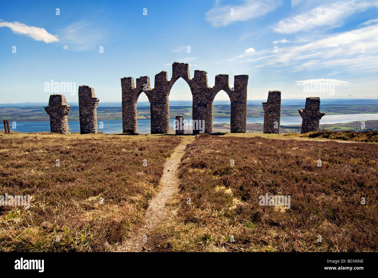 Fyrish monument on a fine day on Fyrish hill, near Evanton, Easter Ross, Scotland said to be a replica of the Gates - Stock Image
