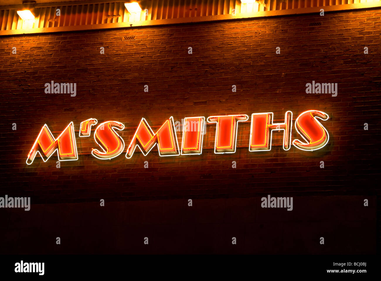 Art Deco neon sign on side of building 'Mr Smiths', Warrington