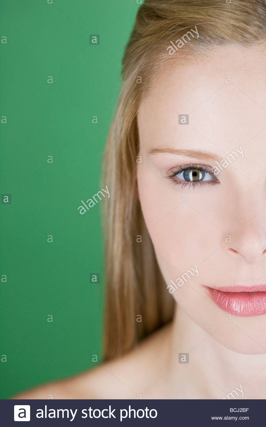 A portrait of a young blonde woman, right hand side of face - Stock Image