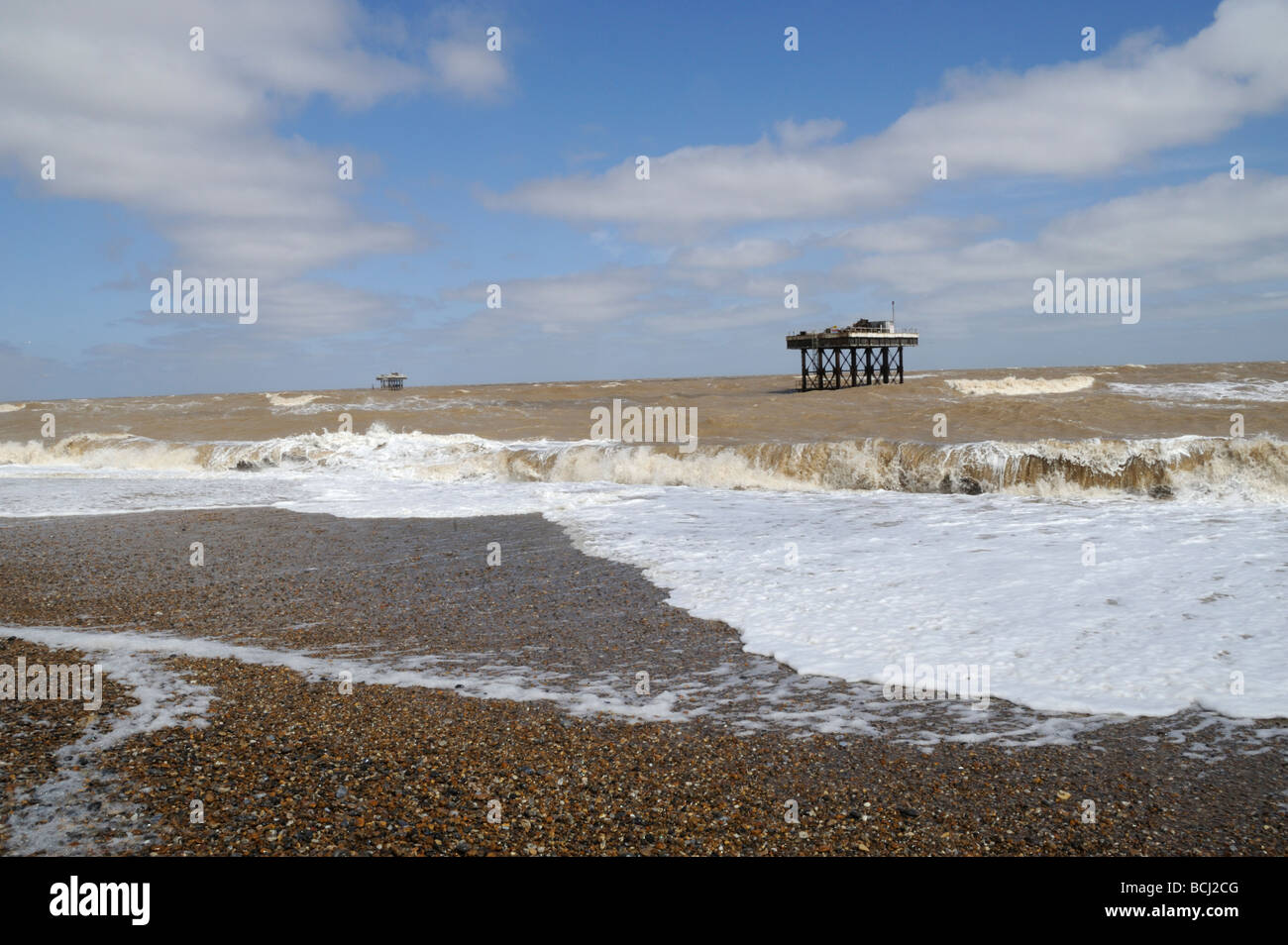 Beach and sea with Sizewell nuclear power station cooling water outlet platform, Suffolk UK - Stock Image