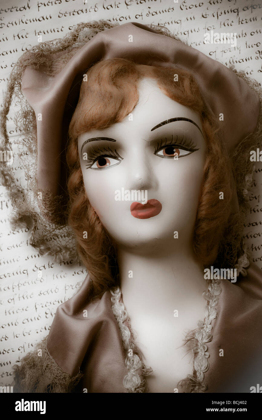 Old doll on old letter - Stock Image