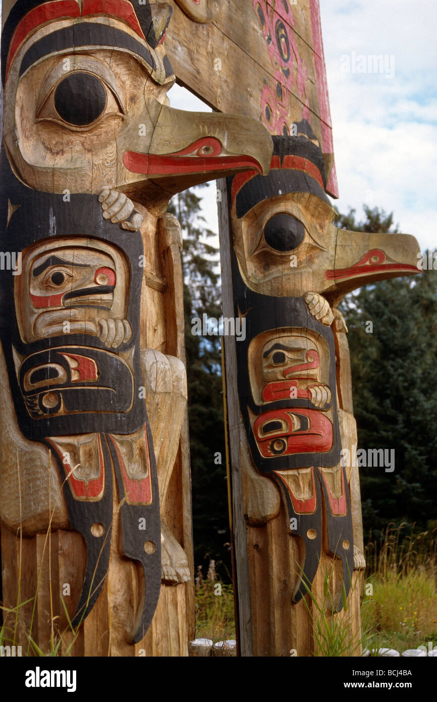 Pair of Totems in Kake Southeast AK summer portrait - Stock Image
