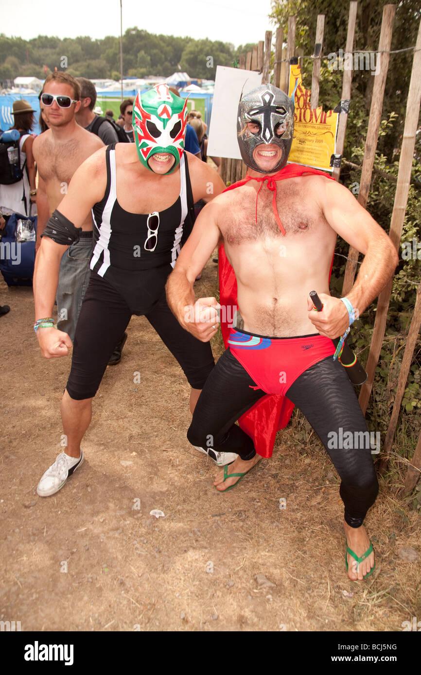 Fancy dress wrestlers at Glastonbury festival 2009. - Stock Image