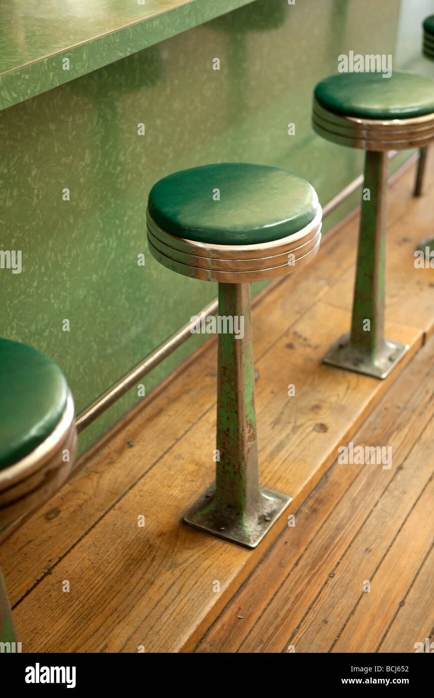 Old stools along counter of diner restaurant cafe Van Alstyne Texas USA - Stock Image