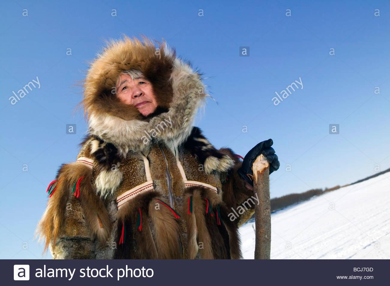 Female Yupik elder in traditional fur parka she made on frozen Kuskokwim River Akiachak Alaska - Stock Image