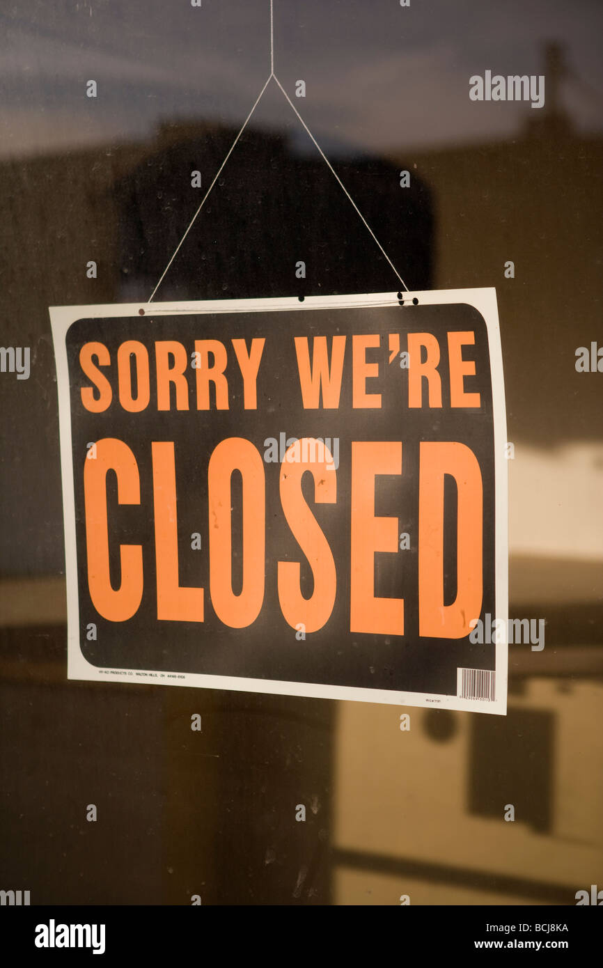 Sign in retail shop store window reading SORRY WE RE CLOSED - Stock Image