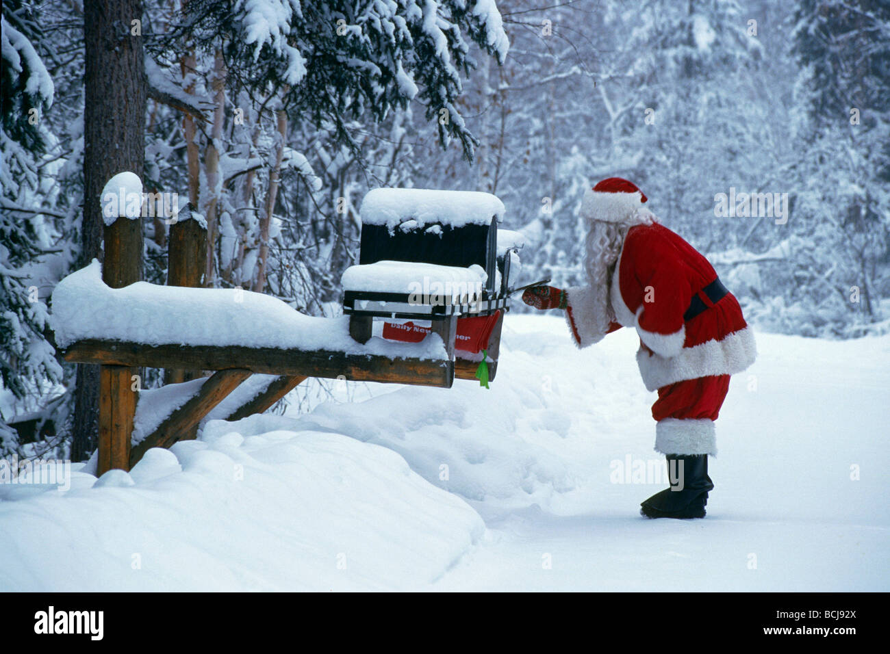 santa claus checking mailbox north pole interior alaska winter portrait stock image - Santa At The North Pole