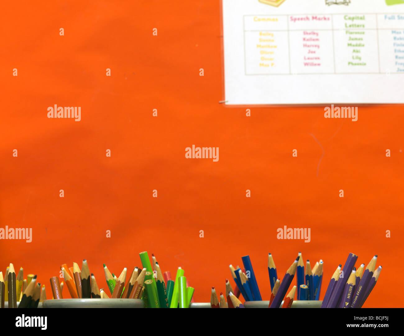 colored pencils in school pots - Stock Image