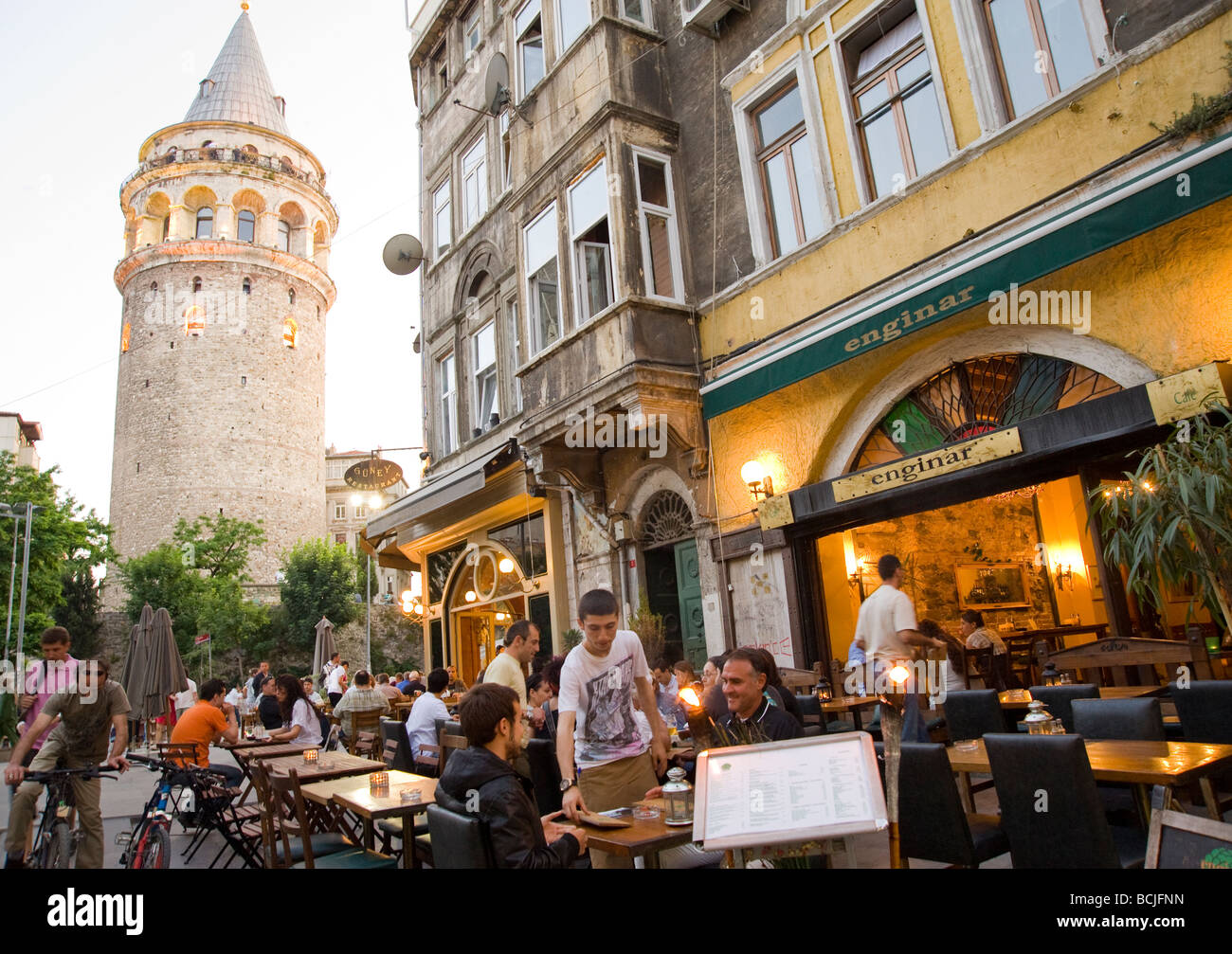 People at a restaurant in Istanbul next to the Galata Tower in Istanbul - Stock Image