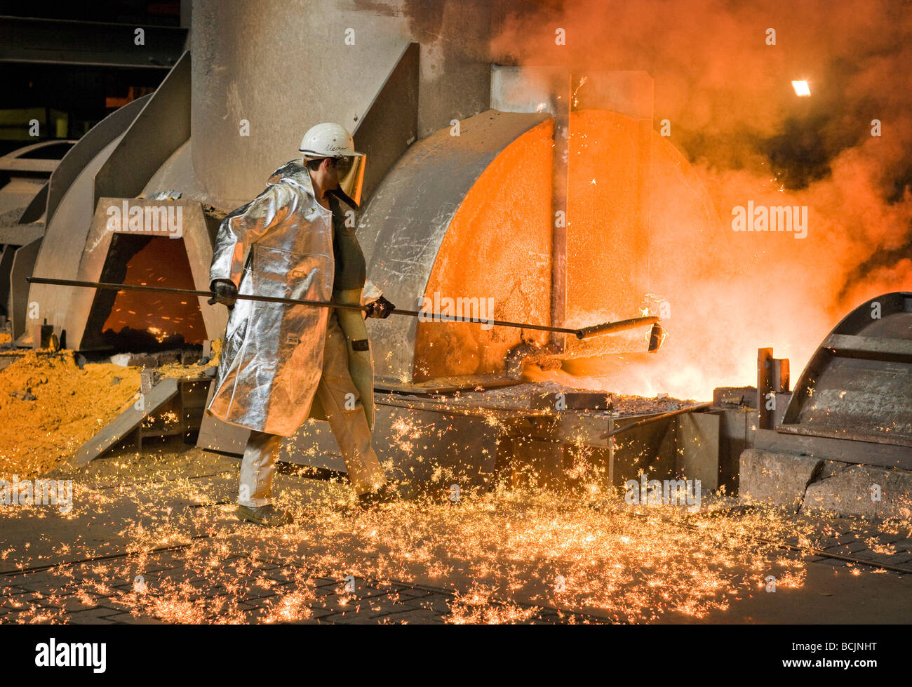Worker with protective clothes at steel plan Stock Photo