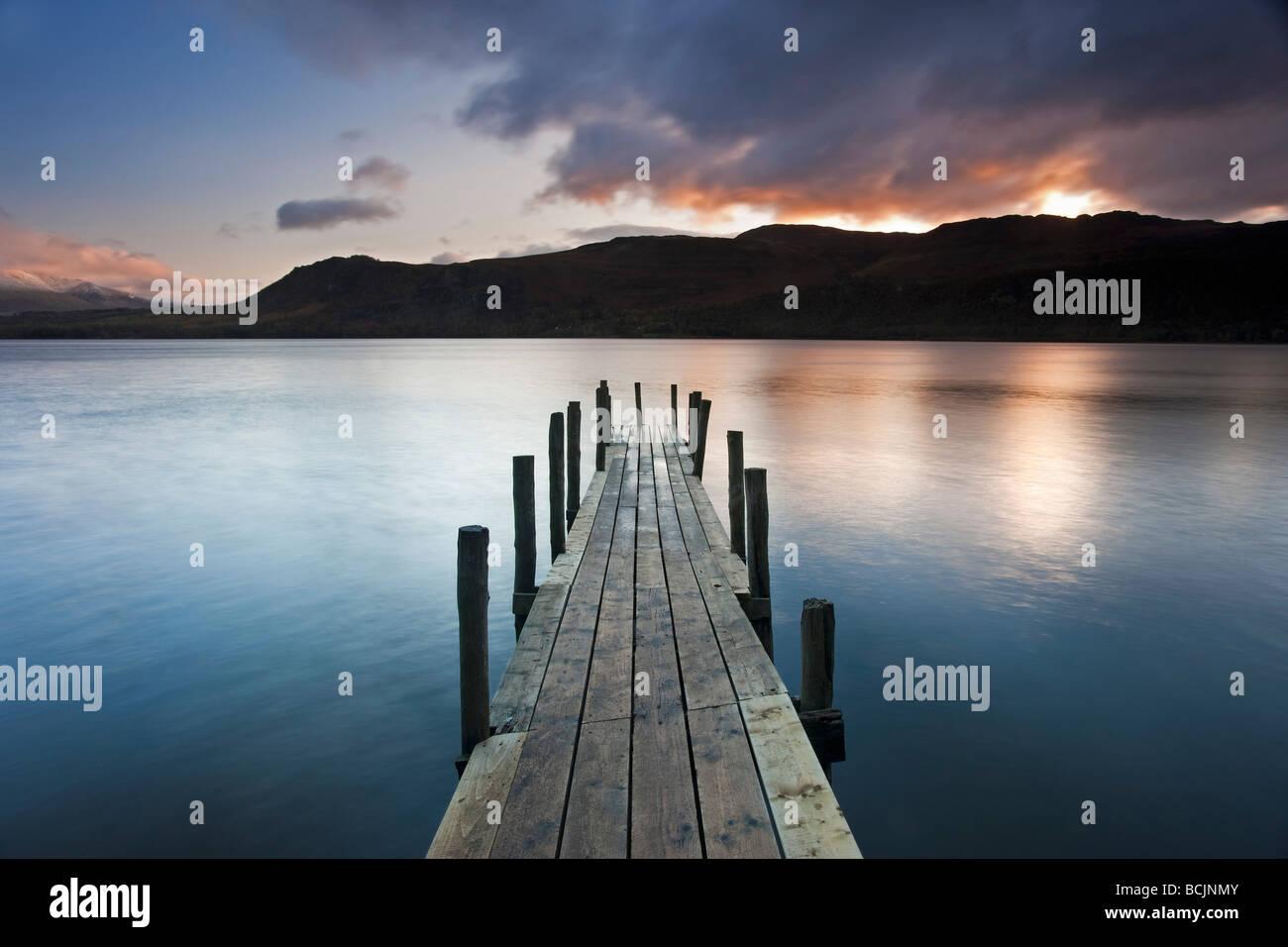 Brandelhow Bay jetty at dawn, Derwentwater, Keswick, Lake District National Park, Cumbria, England, UK - Stock Image
