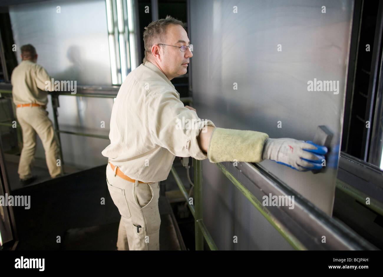 Workers at quality check at ThyssenKrupp Steel AG - Stock Image