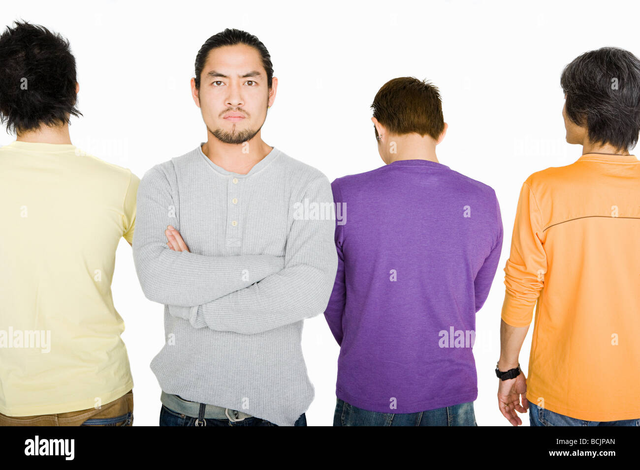 Angry man in row of people - Stock Image