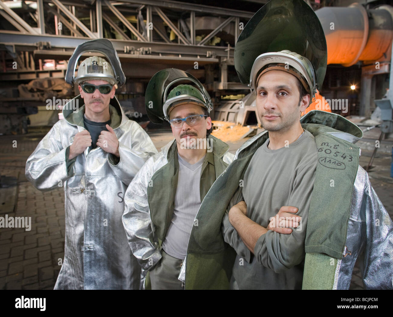 WORKERS WITH PROTECTIVE CLOTHES AT STEELPLANT - Stock Image