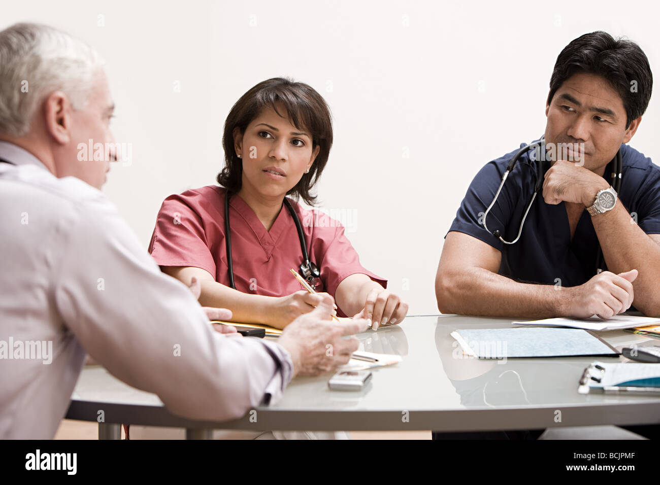 Doctors in a meeting - Stock Image