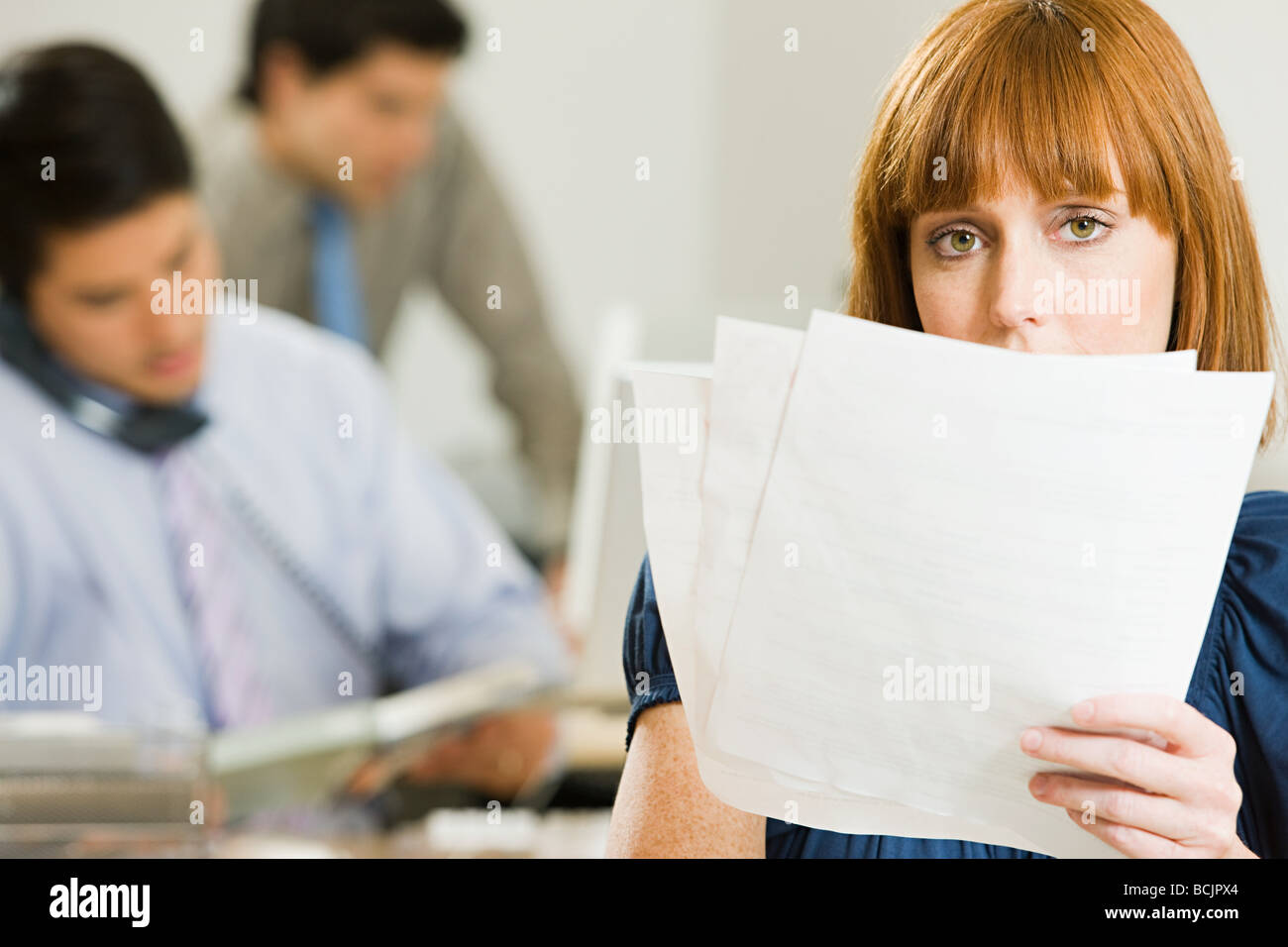 Ginger haired female office worker - Stock Image
