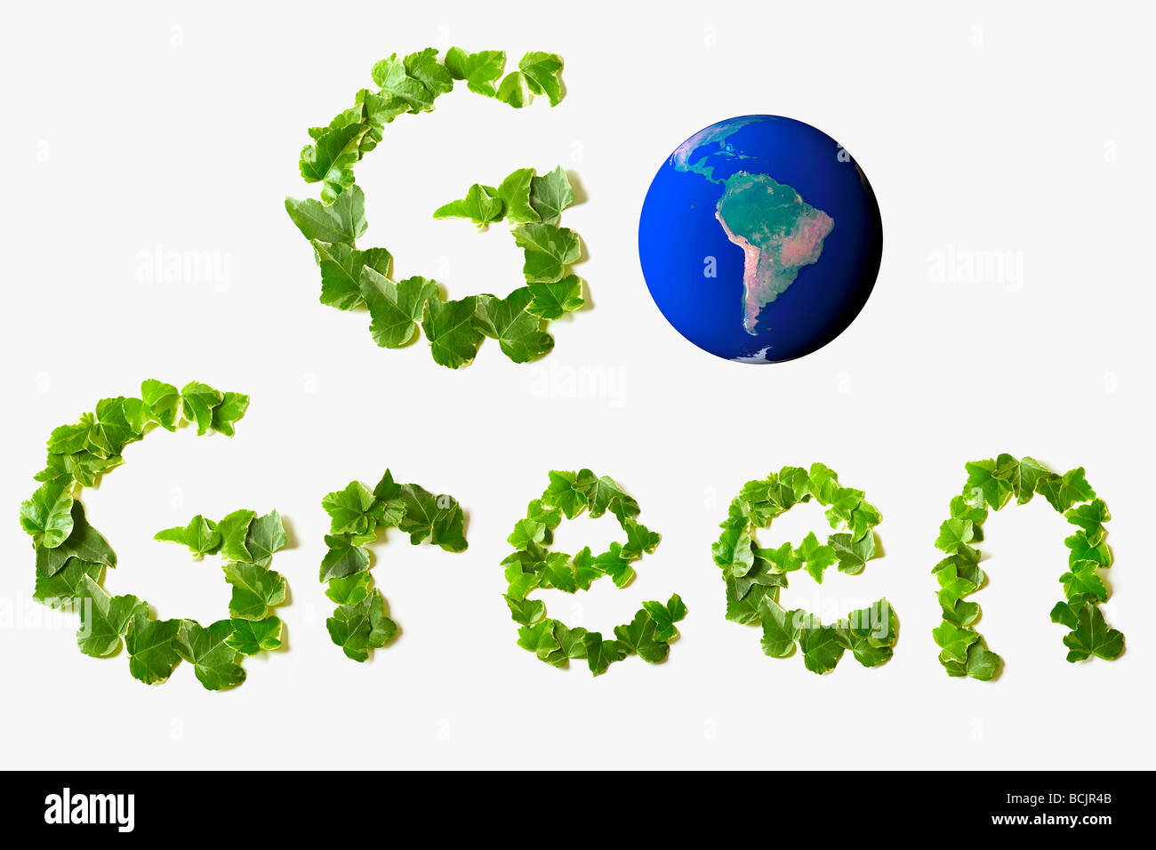 Go green written with leaves and planet earth - Stock Image